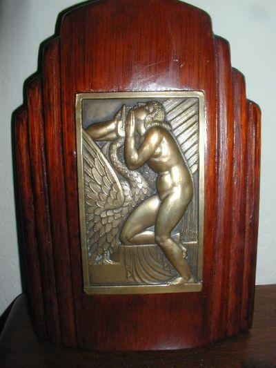 nice large bronze medallion on wooden base