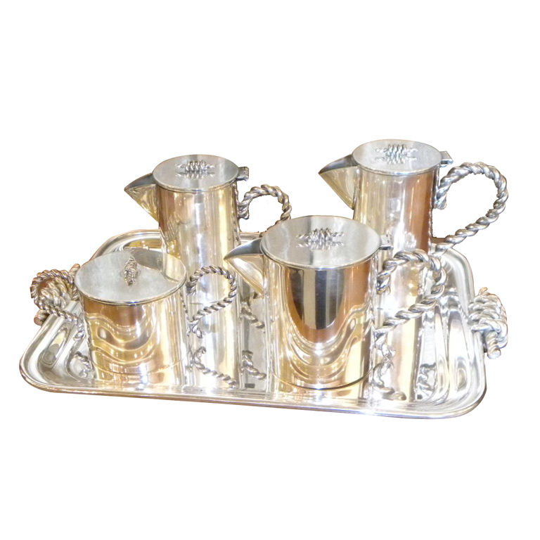 5 piece Coffee -Tea Service with unusual metal-work