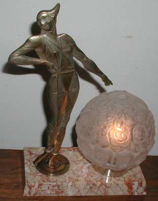 nickeled bronze harlequin statue light