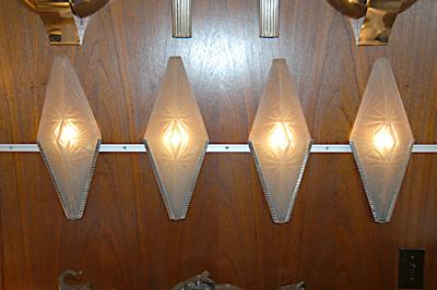 Four wall sconces diamond shaped
