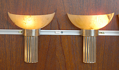 Two torch shaped sconces