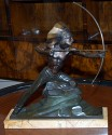 Bronze Statue of an Indian shooting a bow and arrow