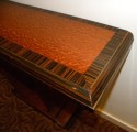 Two-tone Art Deco wood console entry table edge detail