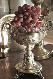 silver chalice and grapes
