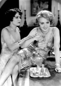 1920s women with decanter and glasses